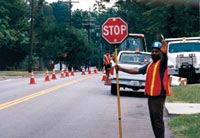 photo of a crossing guard holding a stop sign