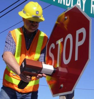 Image of worker working on stop sign